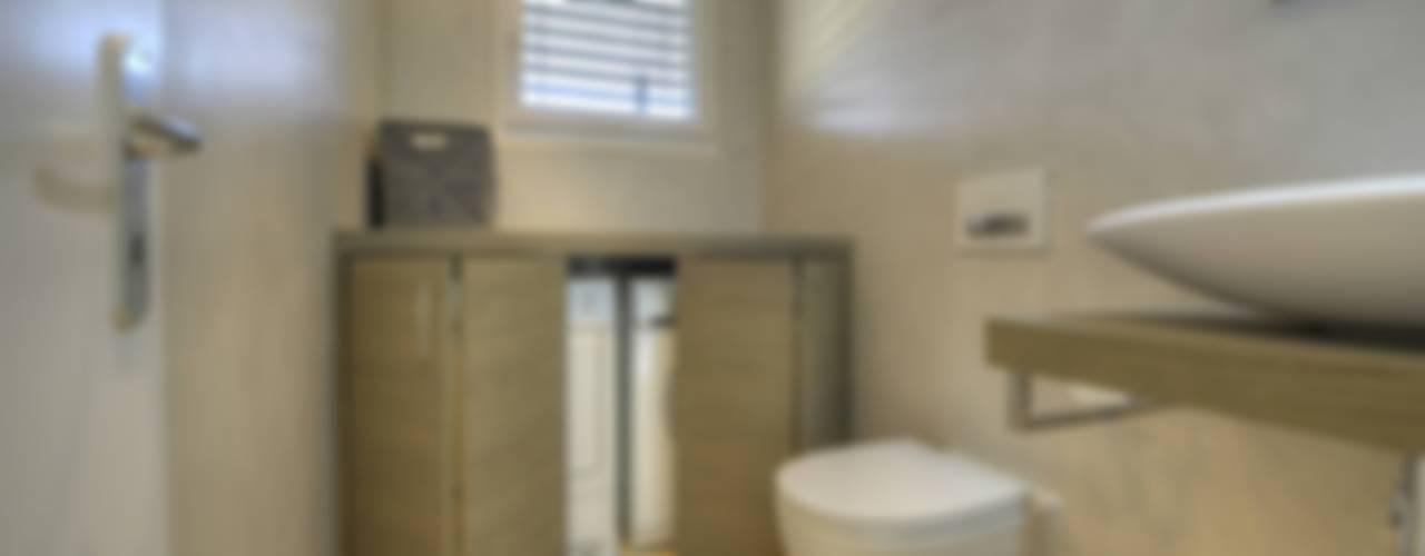 Minimalistische Badezimmer von Archidé SA interior design Minimalistisch