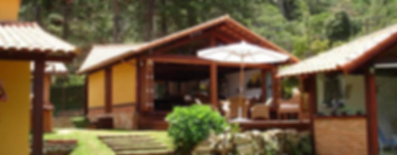 Casas de estilo rústico de Cadore Arquitetura Rústico