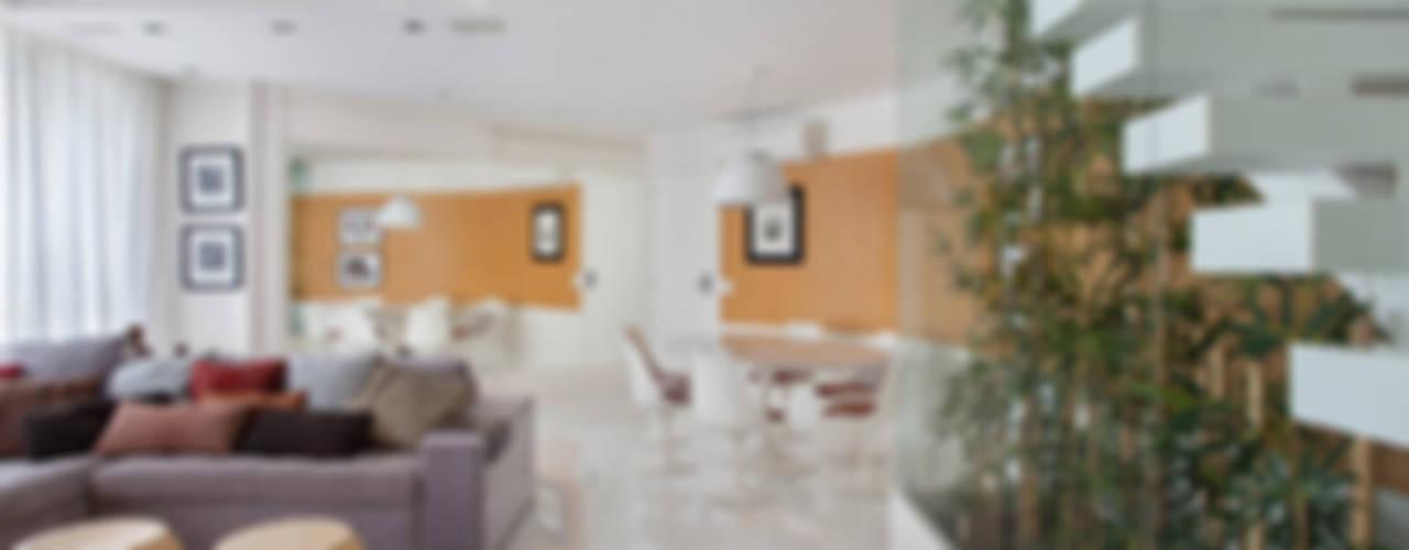 Cobertura Duplex Edificio Mandarim - Condomínio Peninsula: Jardins de inverno  por Cadore Arquitetura