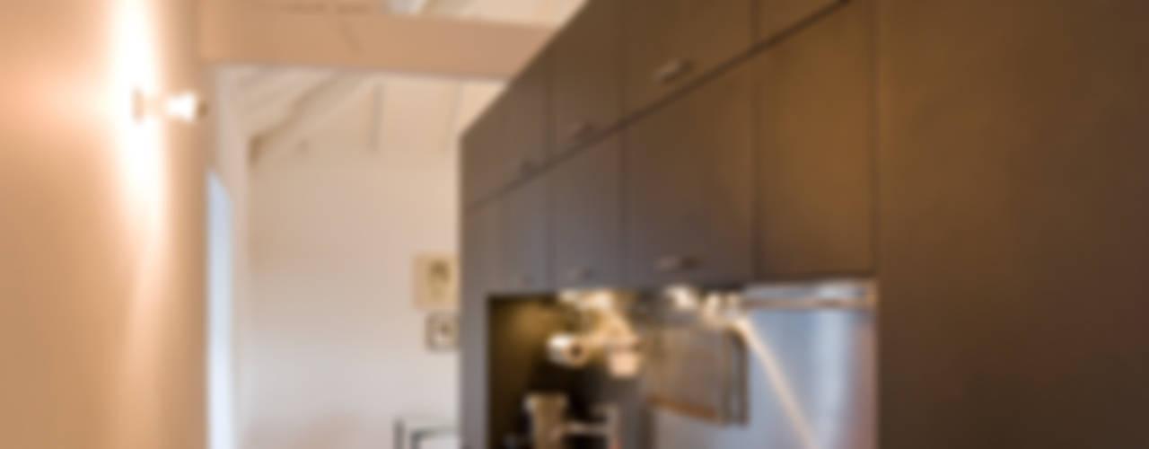 Casa da Vitória: Cozinhas  por Paulo Freitas e Maria João Marques Arquitectos Lda,