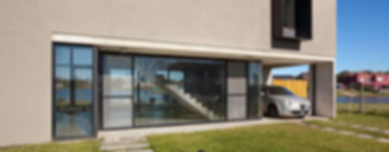 Casa en San Marco: Casas de estilo  por Ruben Valdemarin Arquitecto