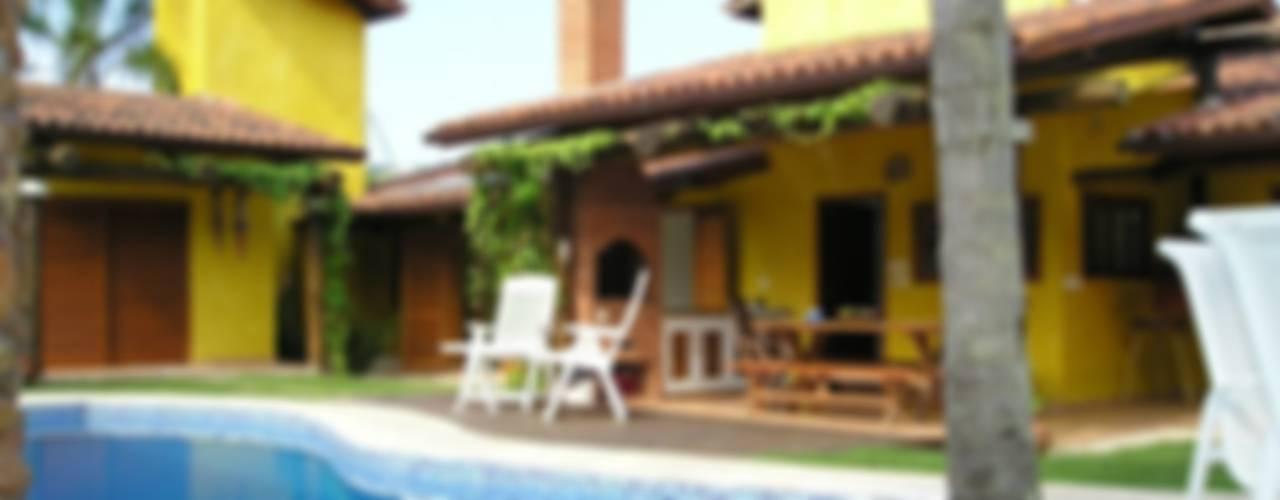 Tropical style houses by Metamorfose Arquitetura e Urbanismo Tropical