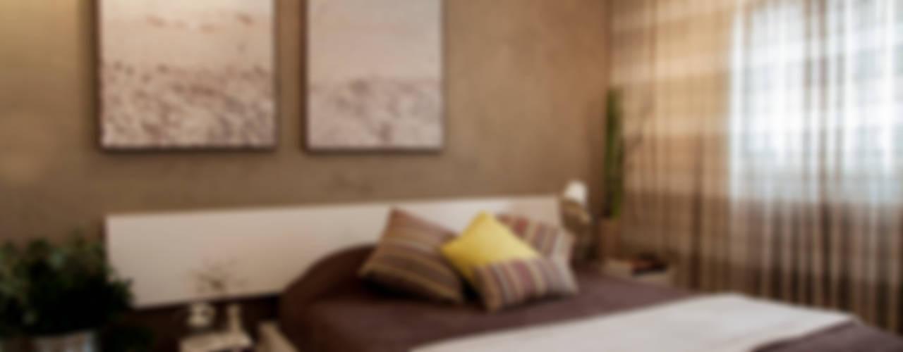 Camera da letto in stile  di Helô Marques Associados