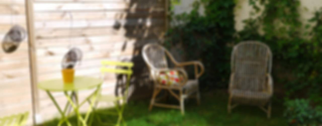 COCON VINTAGE Jardin moderne par Agence Laurent Cayron Moderne