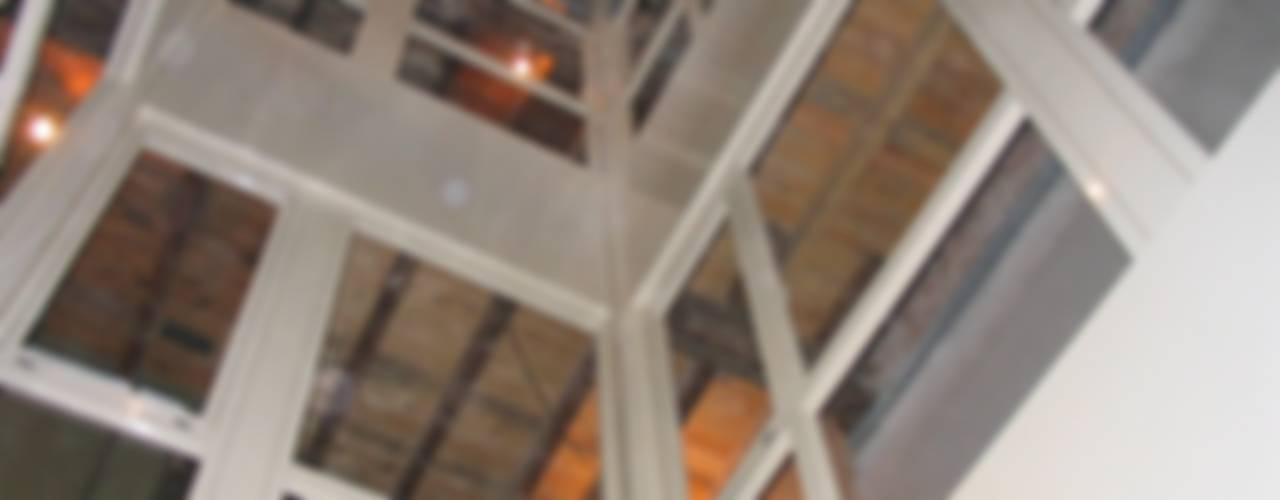 Rehabilitación de Edificio para Viviendas y Locales Comerciales de BR&C arquitectos