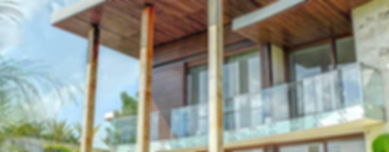 CASA JT Balcones y terrazas tropicales de Ancona + Ancona Arquitectos Tropical