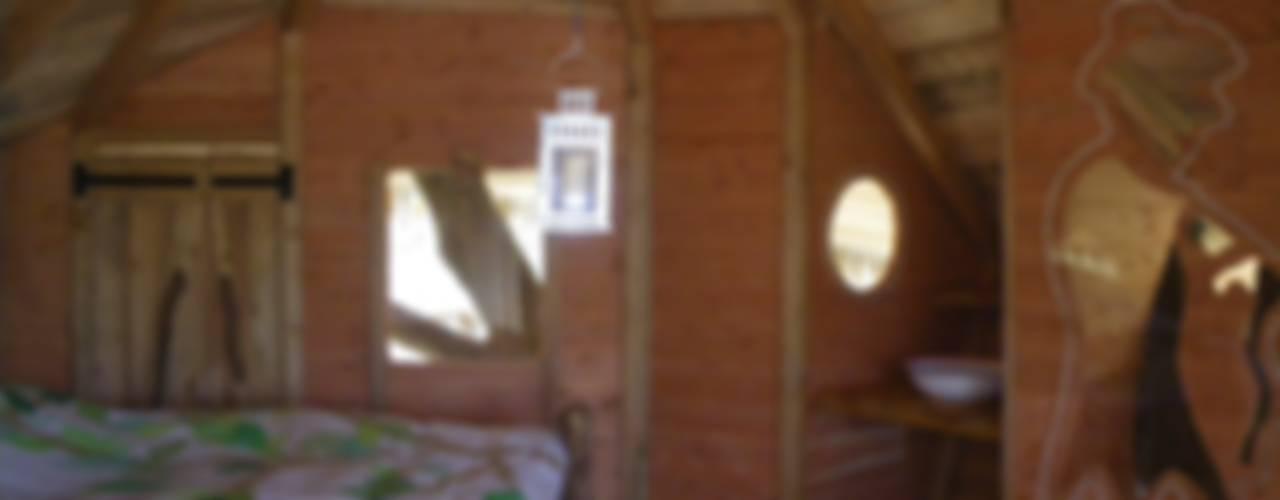 Une cabane dans les arbres:  de style  par Les cabanes de Fontaine