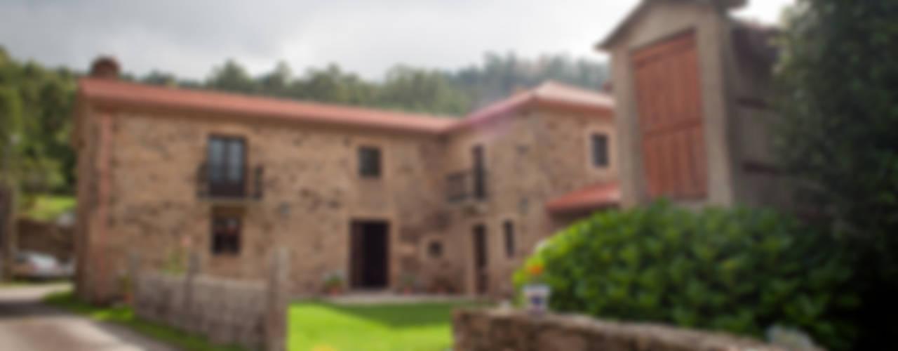Casas de estilo  por Intra Arquitectos, Rural