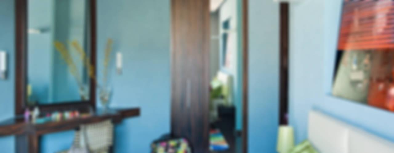 La casa ideale per un single, giovane e colorata di PDV studio di progettazione Eclettico