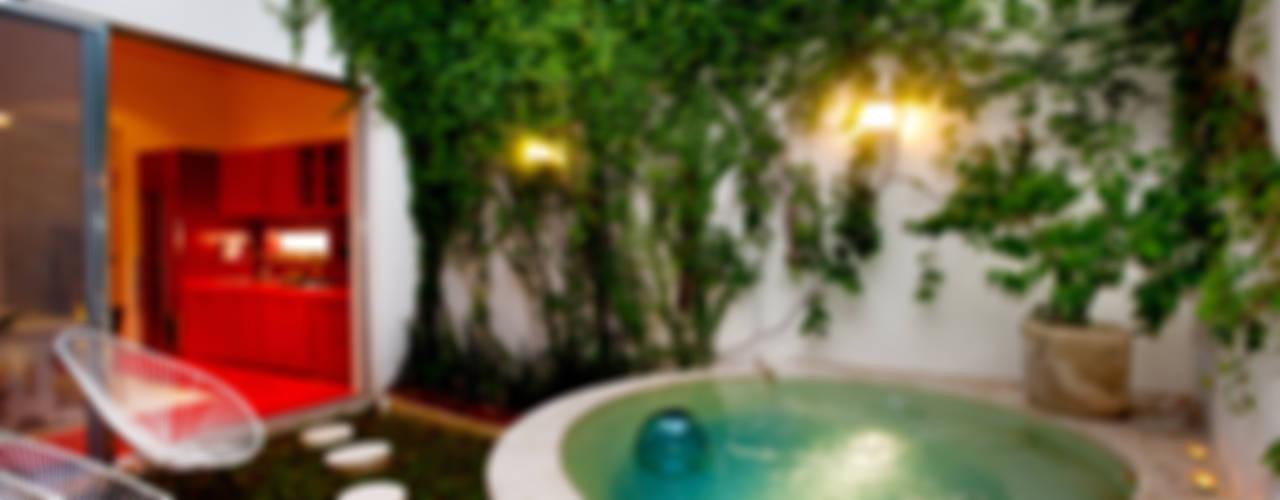 Casa Santiago 49: Albercas de estilo  por Taller Estilo Arquitectura