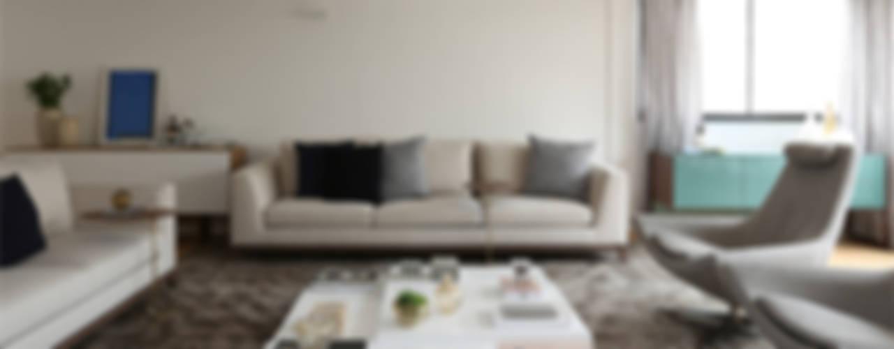 Perdizes III: Salas de estar  por Casa 2 Arquitetos