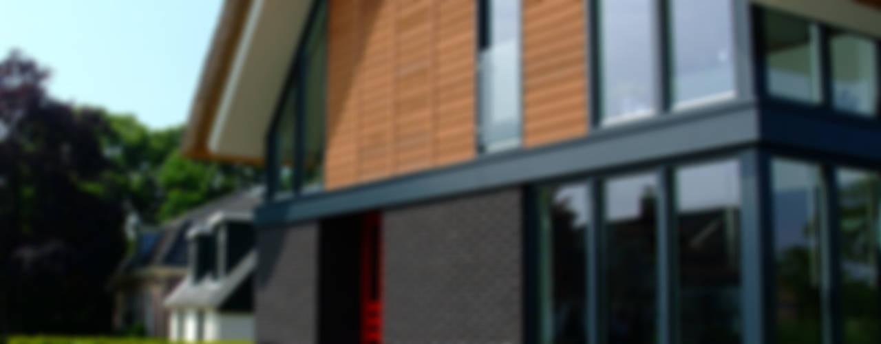 Modern binnen traditionele grenzen:  Huizen door MEF Architect