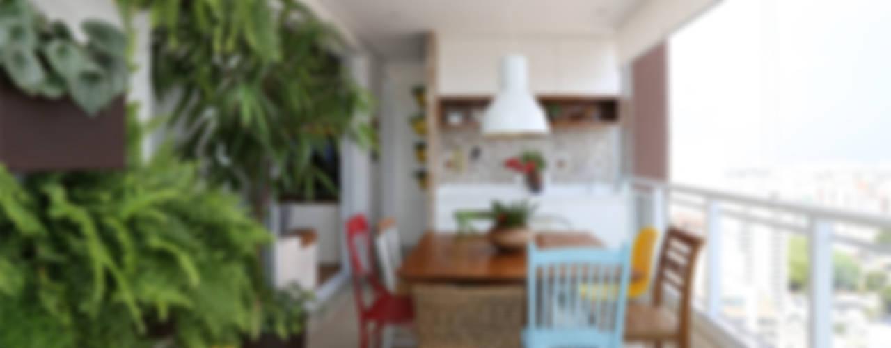 Apartamento LD: Terraços  por Duda Senna Arquitetura e Decoração