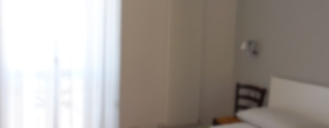 Dormitorios minimalistas de gk architetti (Carlo Andrea Gorelli+Keiko Kondo) Minimalista