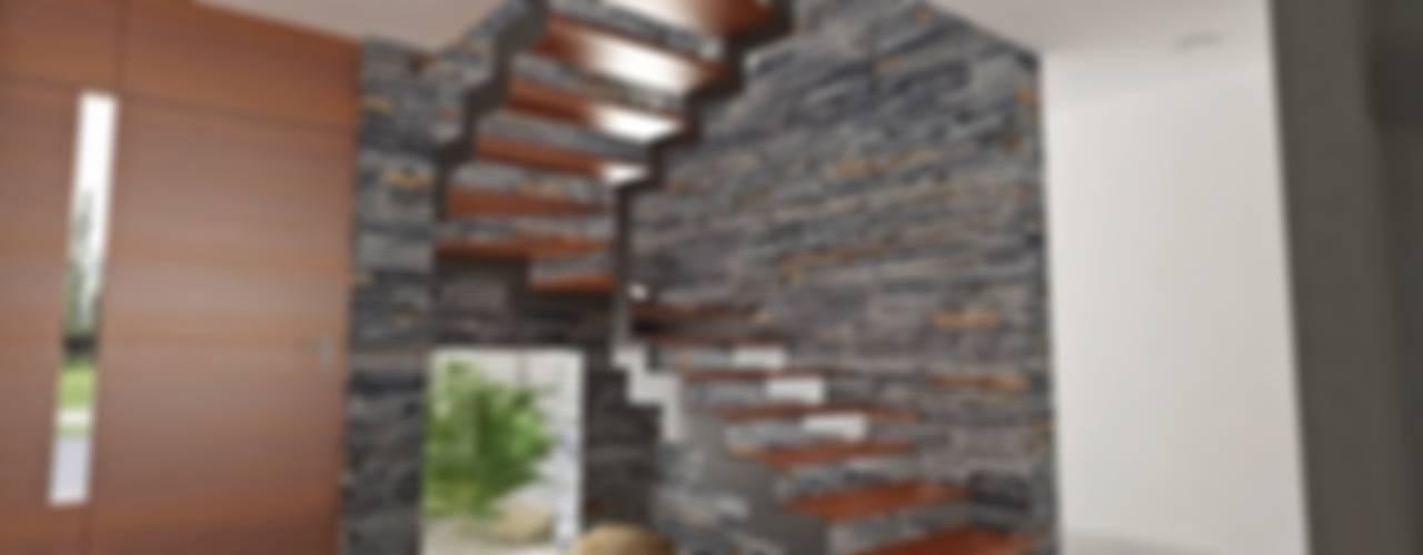 Pasillos, vestíbulos y escaleras modernos de Chazarreta-Tohus-Almendra Moderno