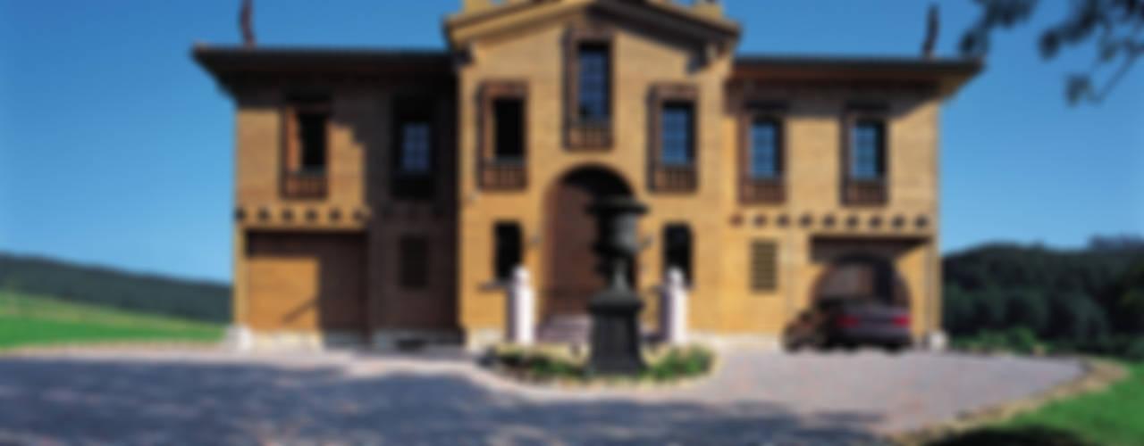 Case in stile rustico di ELK Fertighaus GmbH Rustico