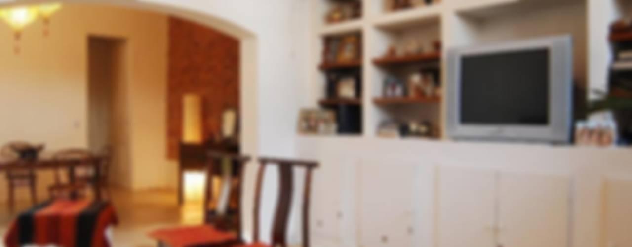 Eclectische woonkamers van Parrado Arquitectura Eclectisch