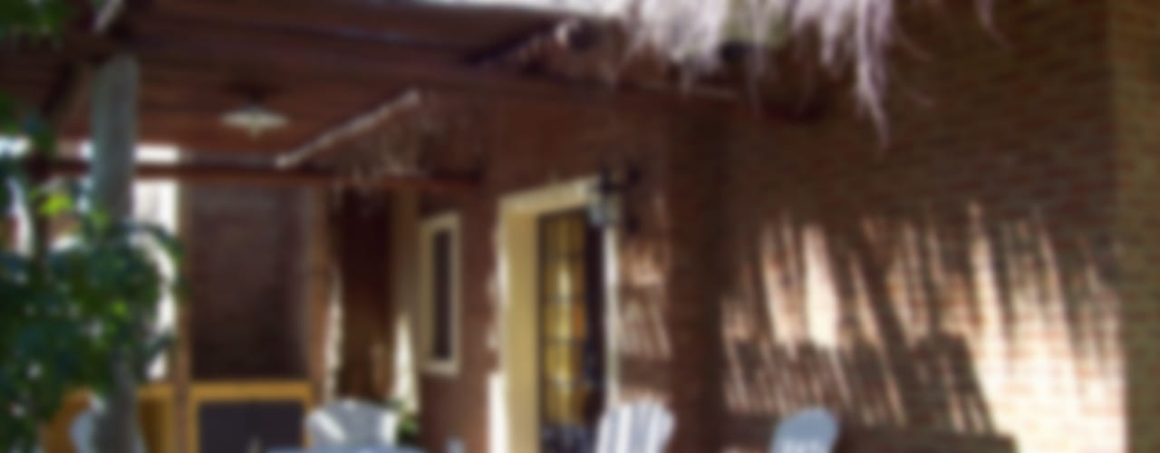 Hotel in stile rustico di D'ODORICO arquitectura Rustico