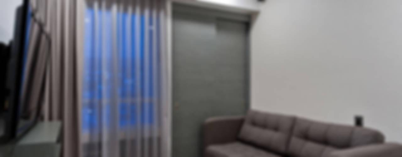 Salas multimedia de estilo  por HO arquitectura de interiores
