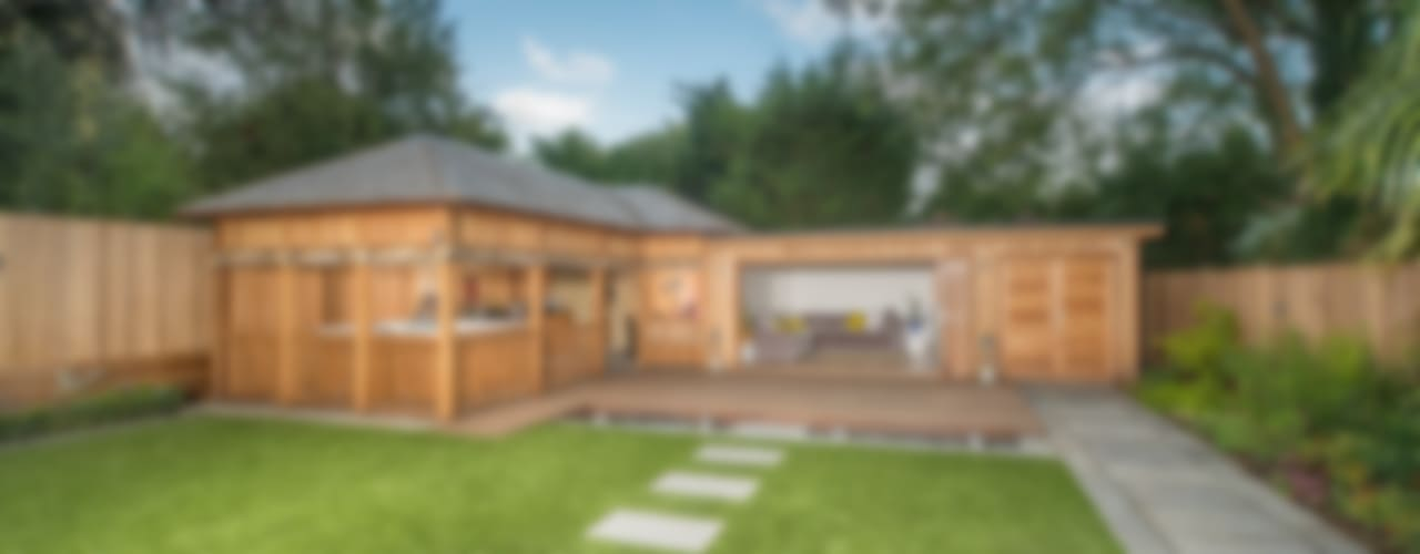 Bespoke garden building complete with spa and kitchen:  Garage/shed by Crown Pavilions,