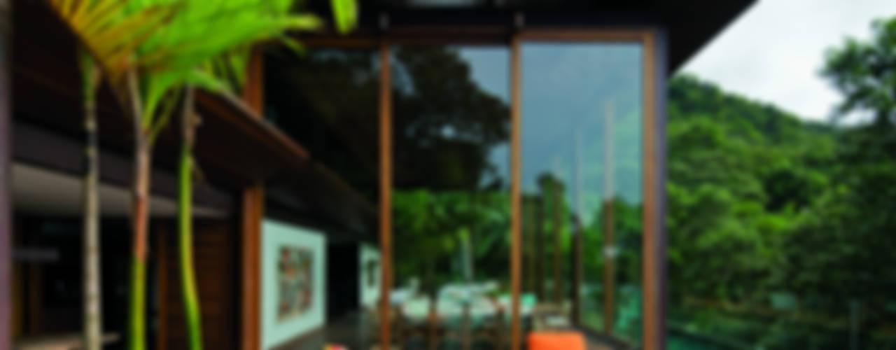 Casas tropicais por Jacobsen Arquitetura Tropical