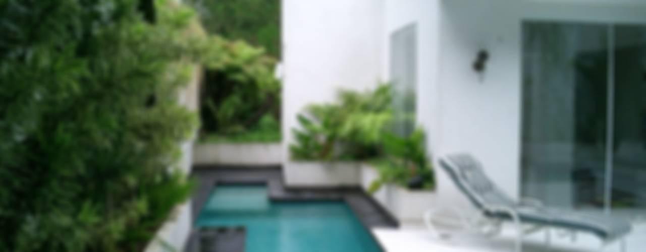 مسبح تنفيذ Kika Prata Arquitetura e Interiores.