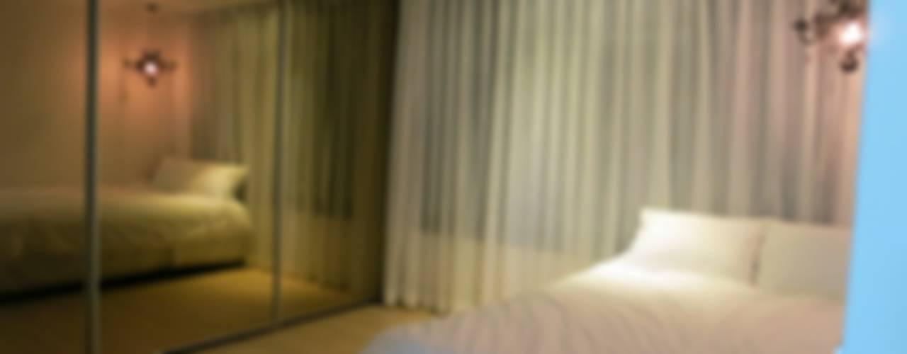 Phòng ngủ phong cách hiện đại bởi 홍예디자인 Hiện đại