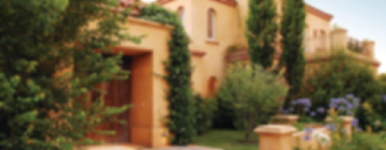 Casas de estilo clásico de JUNOR ARQUITECTOS Clásico