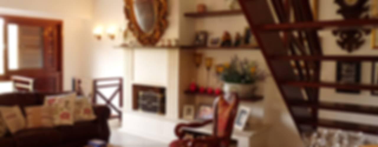 Casa na Serra de Guaramiranga, Ceará: Salas de estar  por Eveline Sampaio Arquiteta e Designer de Interiores