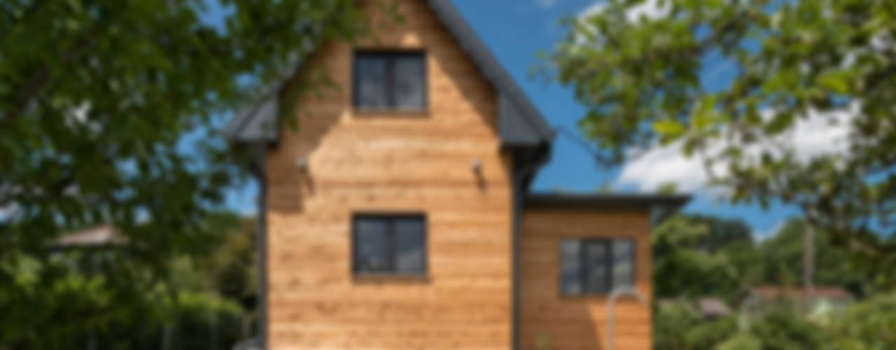 Wohnen im Sommerhause Moderne Häuser von UNA plant Modern