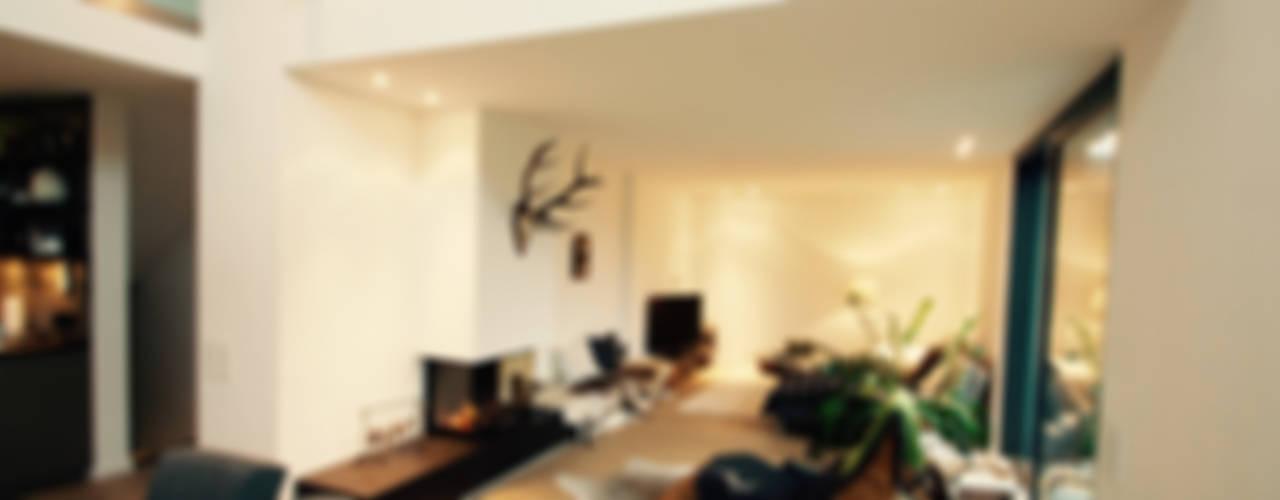 Salones modernos de moser straller architekten Moderno