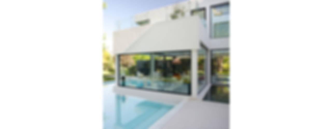 CASA CARRARA: Casas de estilo  por Remy Arquitectos