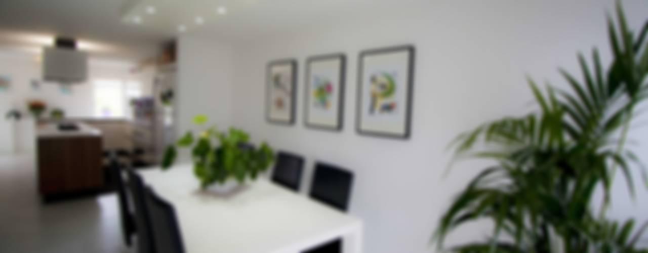 Comedores de estilo moderno por Studio HAUS