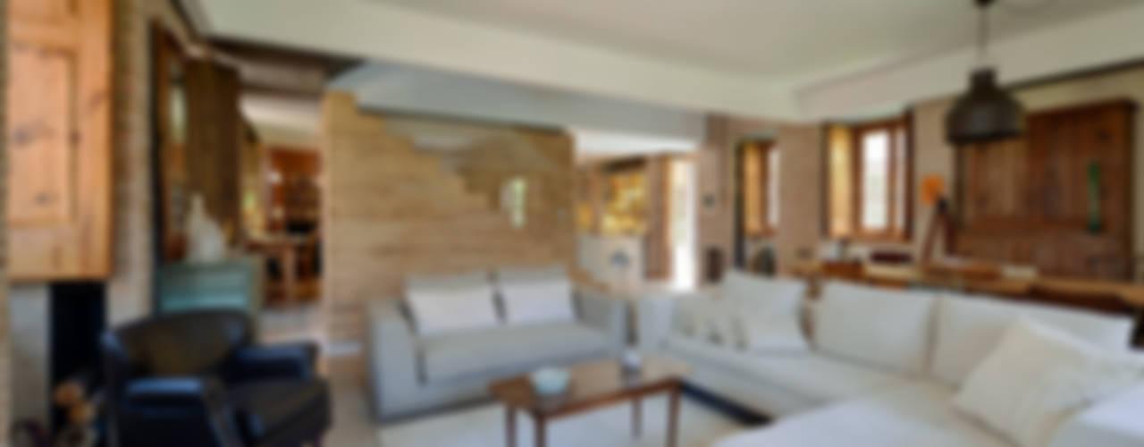 Livings de estilo  por Ricardo Moreno Arquitectos