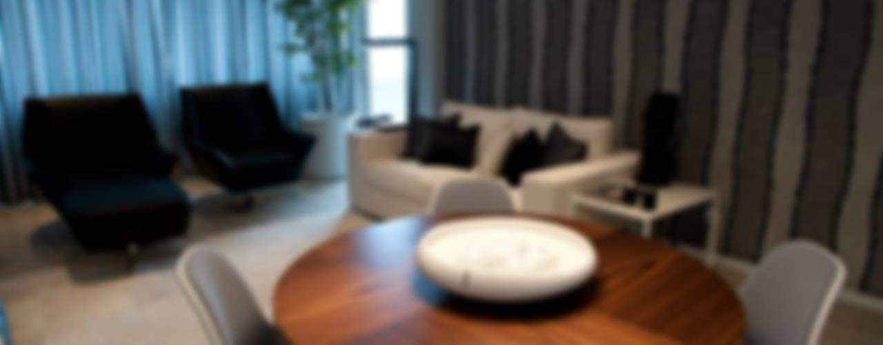 BAÍA, LUANDA Salas de estar modernas por Spaceroom - Interior Design Moderno