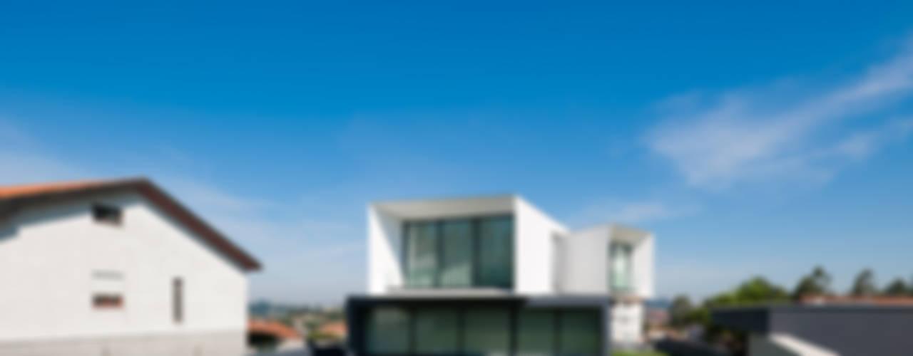 Casas de estilo  por Urban Core , Minimalista