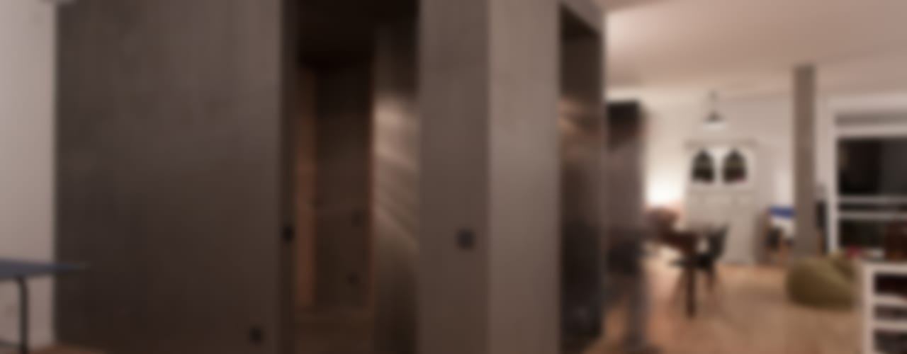 Apartamento BAC: Salas de estar  por URBAstudios,