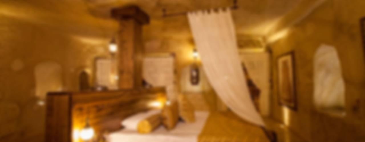 Спальня в рустикальном стиле от Kayakapi Premium Caves - Cappadocia Рустикальный