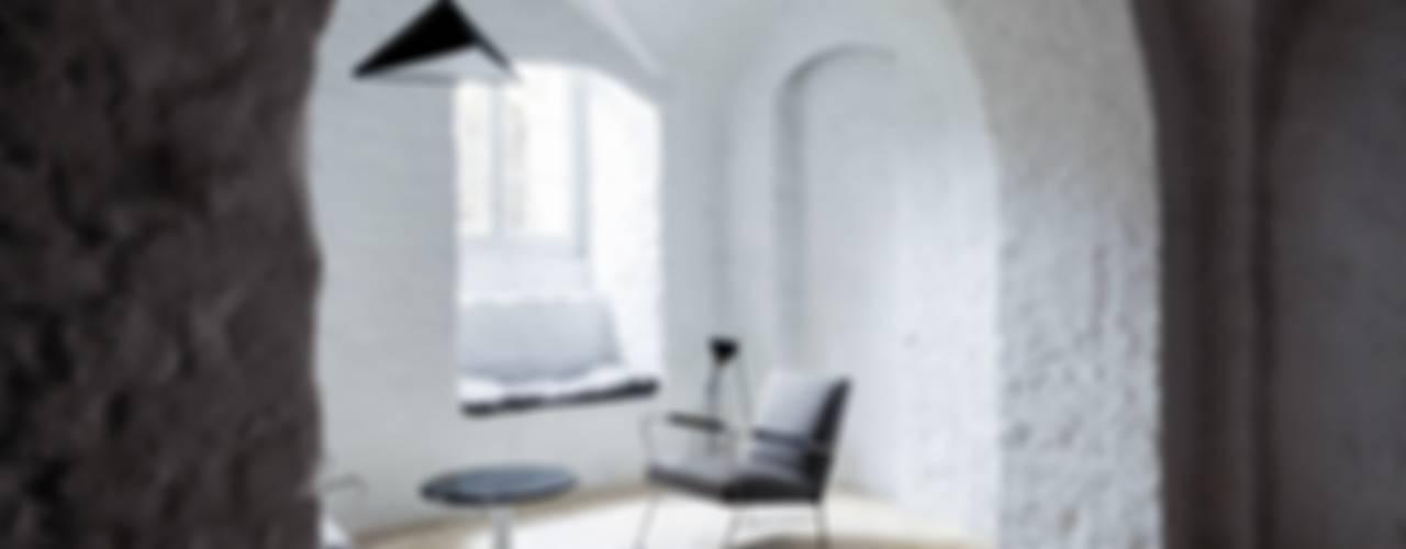 Letnie mieszkanie pod Berlinem Loft Kolasiński Skandynawska piwnica win Cegły Szary