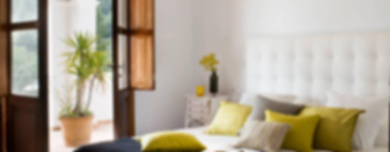 Casa en Ibiza Dormitorios de estilo rural de recdi8 Rural