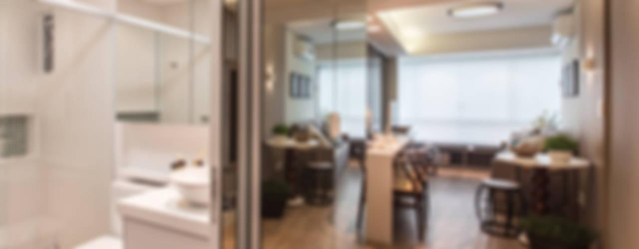 Salones modernos de Claudia Stach e Daniela Bordignon Arquitetura Moderno