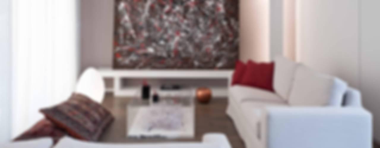 Ristrutturazione di un appartamento a Napoli Soggiorno minimalista di architetto Lorella Casola Minimalista