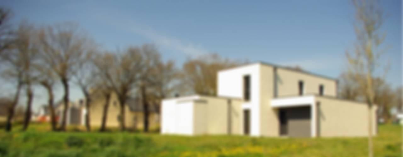 Construction d'une maison individuelle, Pleumeleuc, Ille-et-Vilaine Maisons modernes par bAAt architecture Moderne