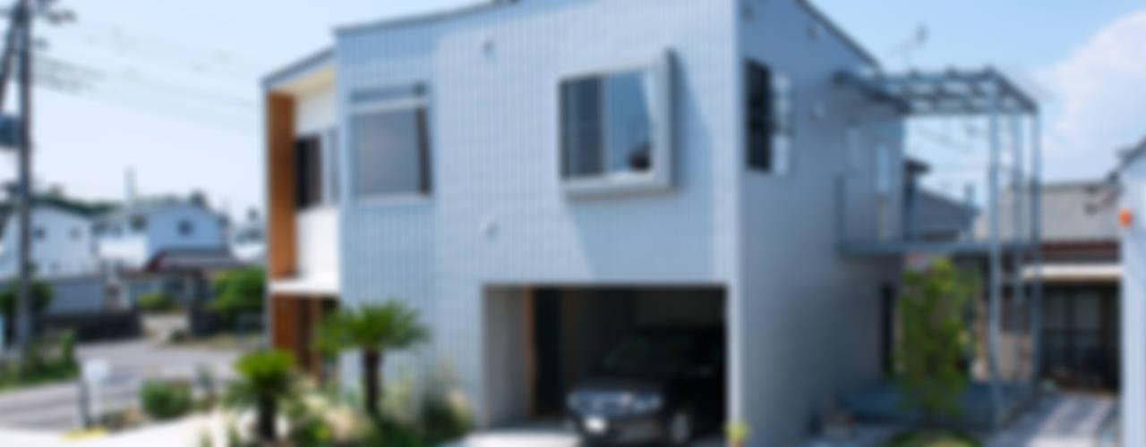 Casas de estilo  por アーキライン一級建築士事務所