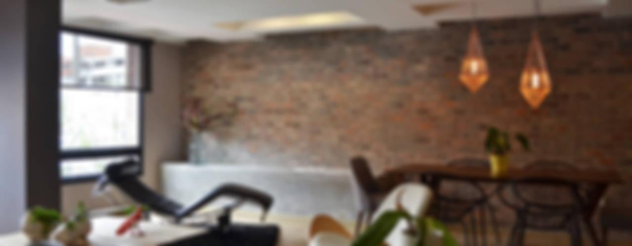 Livings de estilo  por santiago dussan architecture & Interior design