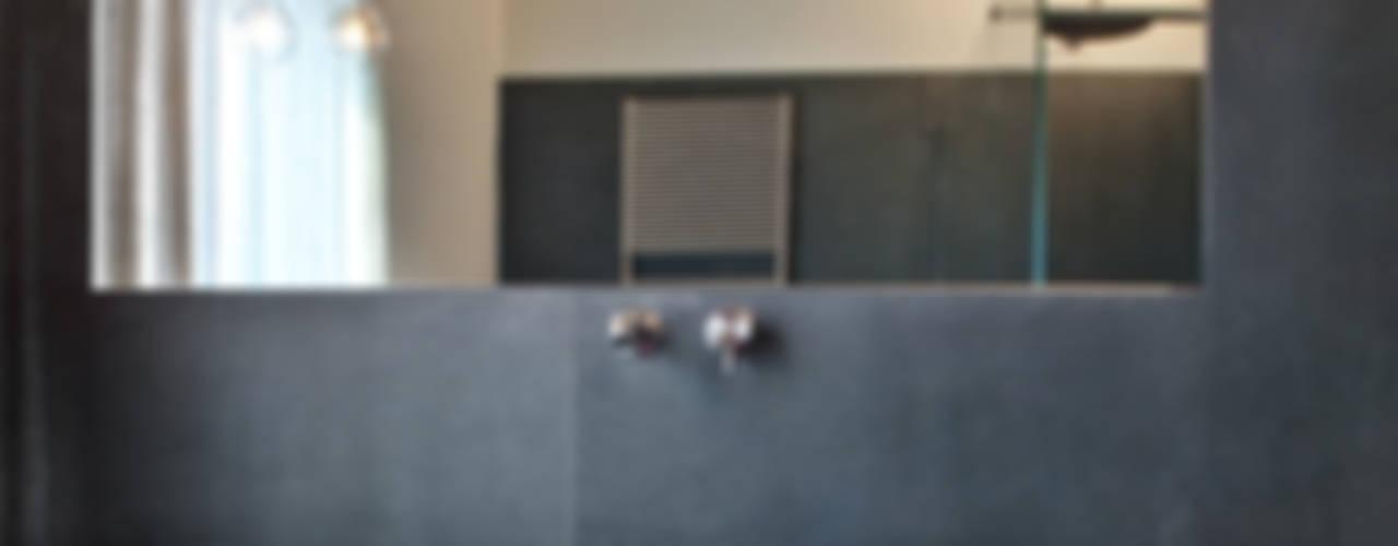 Baños de estilo rústico de MIDE architetti Rústico