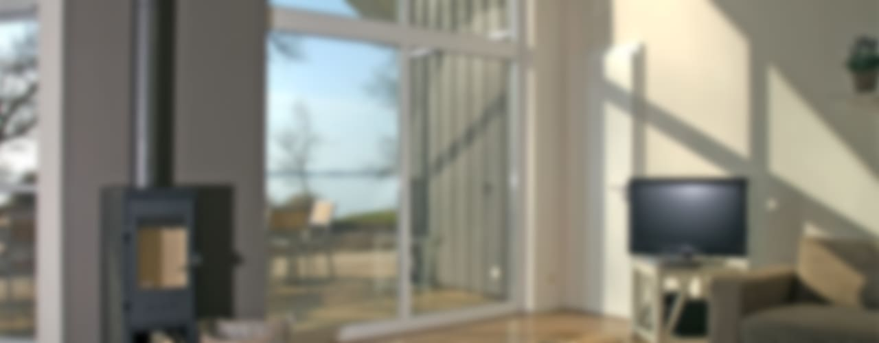 Helles Ferienhaus am Wieker Bodden Moderne Wohnzimmer von Büro Köthe Modern
