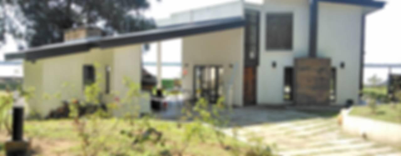 VIVIENDAS UNIFAMILIARES Casas modernas: Ideas, imágenes y decoración de E-PROYECT Moderno