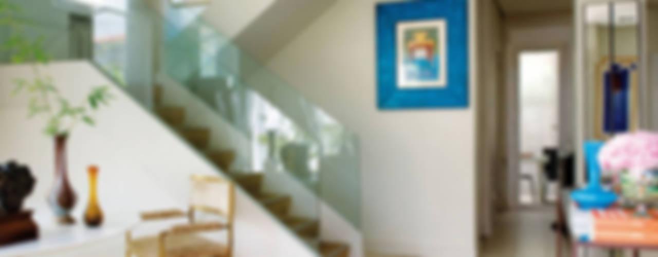 Duplex familiar Salones de estilo ecléctico de Estudio de Arquitectura Teresa Sapey Ecléctico