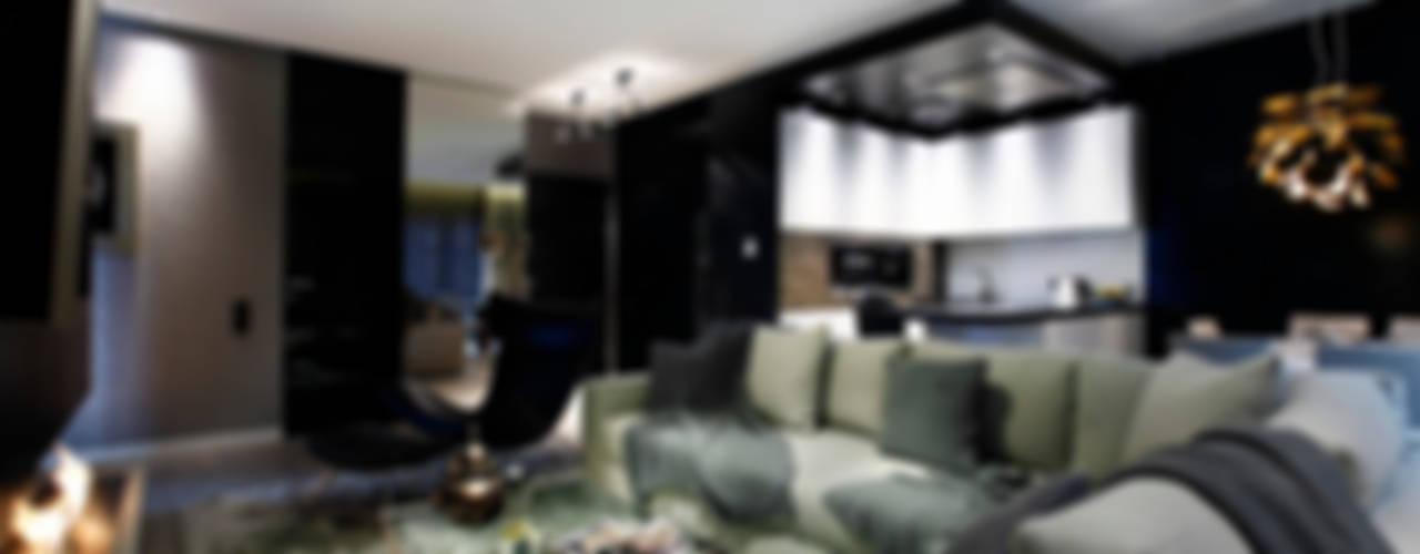 Elegancki apartament, w którym króluje czerń Nowoczesny salon od FLOW Franiak&Caturowa Nowoczesny